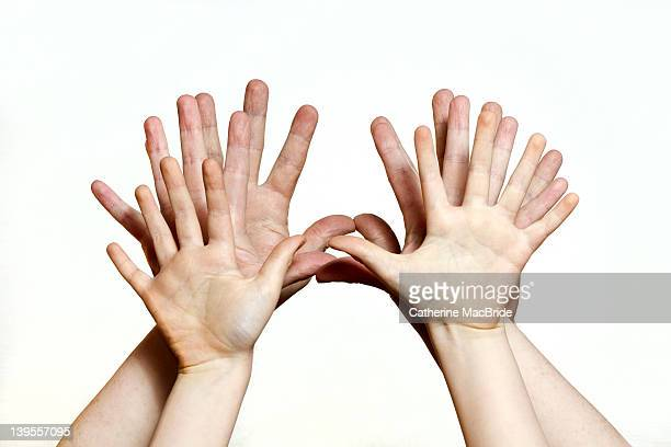 Family of outstretched hands