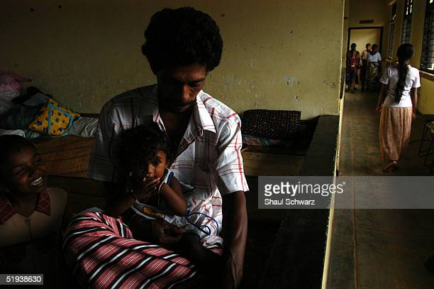 A family of refugees from the tsunami disaster crowds in to a room at the local school January 8 2005 in Matara Sri Lanka Two of the schools in town...