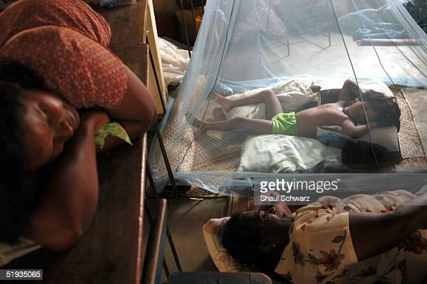 A family of refugees from the tsunami disaster crowds into a room at the local school January 9 2005 in Matara Sri Lanka Two of the schools in town...