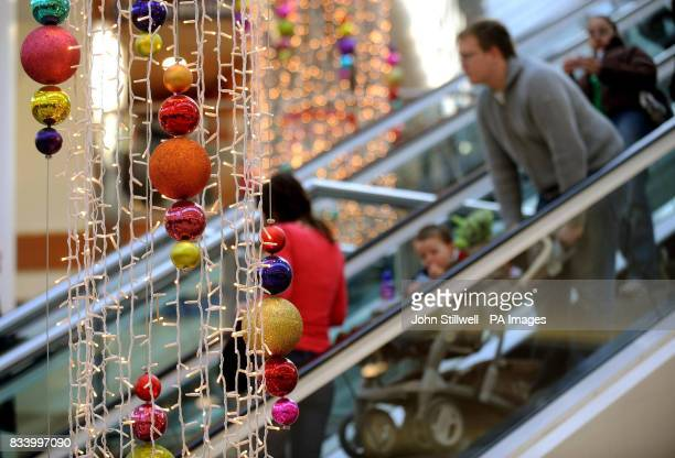 A family of shoppers in Lakeside shopping centre in Essex where shoppers were out in force with less than two weeks before the Christmas holiday