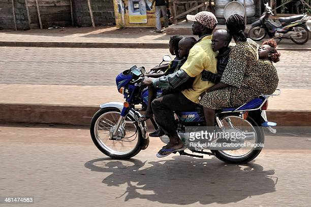 Family of six members riding a motorbike on the streets