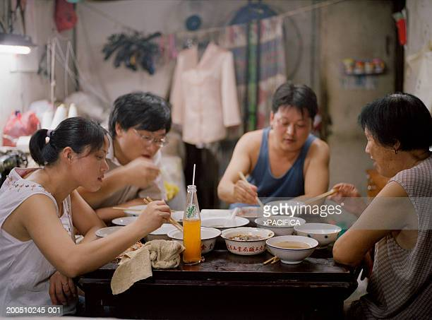 Family of tailors having dinner