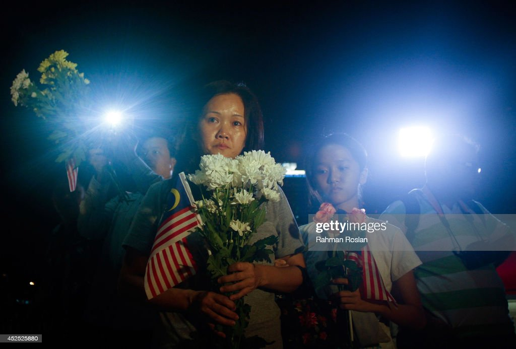 Family of the crew members of MH17 pay their respect during a vigil on July 22, 2014 in Kuala Lumpur, Malaysia. Malaysia Airlines flight MH17 was travelling from Amsterdam to Kuala Lumpur when it crashed killing all 298 on board including 80 children. The aircraft was allegedly shot down by a missile and investigations continue over the perpetrators of the attack.