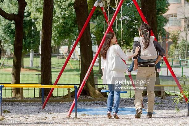 Family of Three at Playground