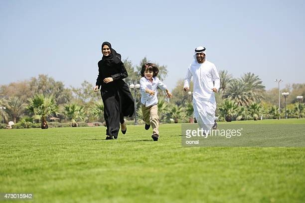 Family of three enjoying their leisure time in a park