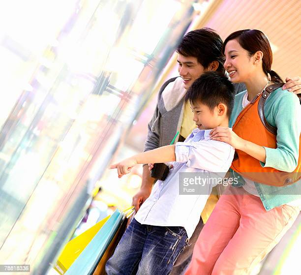 Family of Three in a Shopping Mall