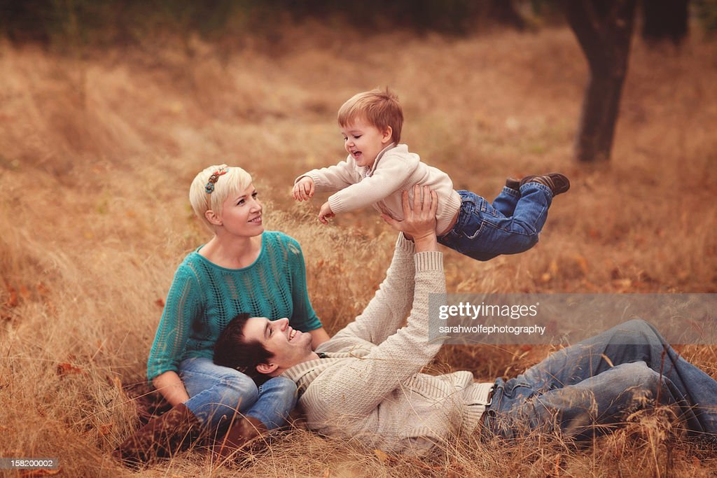 family of three playing together : Stock Photo