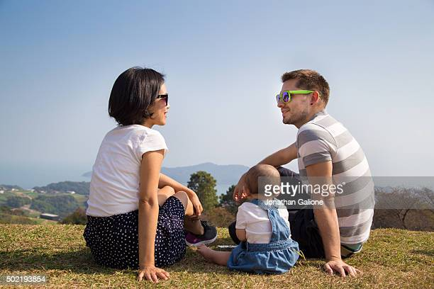 Family of three sitting outside