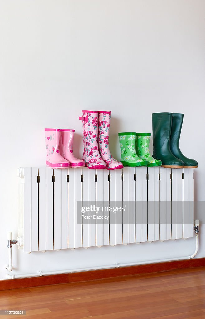 Family of wellington boots on radiator