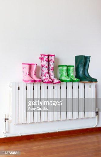 Family of wellington boots on radiator