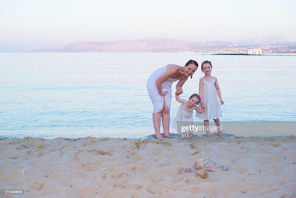 Family of white dresses : Stock Photo