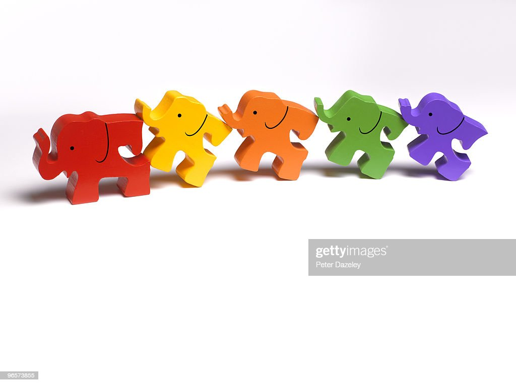 Family of wooden toy elephants in a line : Stock Photo