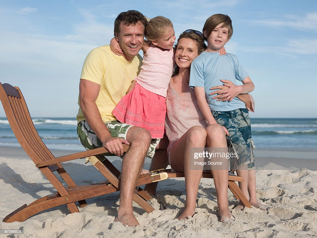 Family on a lounge chair : Stock Photo