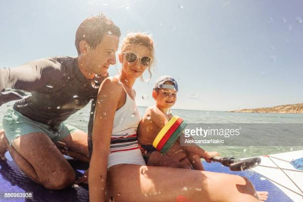 Family on a paddle board