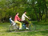 Family on a tandem bike
