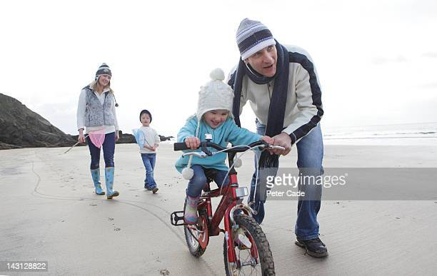 Family on beach in winter