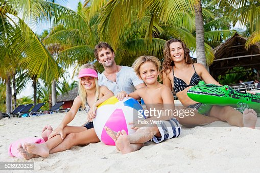 Family on beach on summer day : Stock Photo