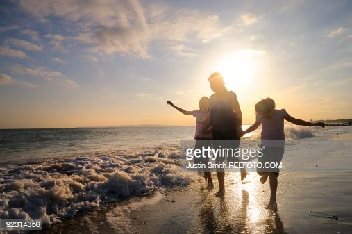 Family on beach  : Stock Photo