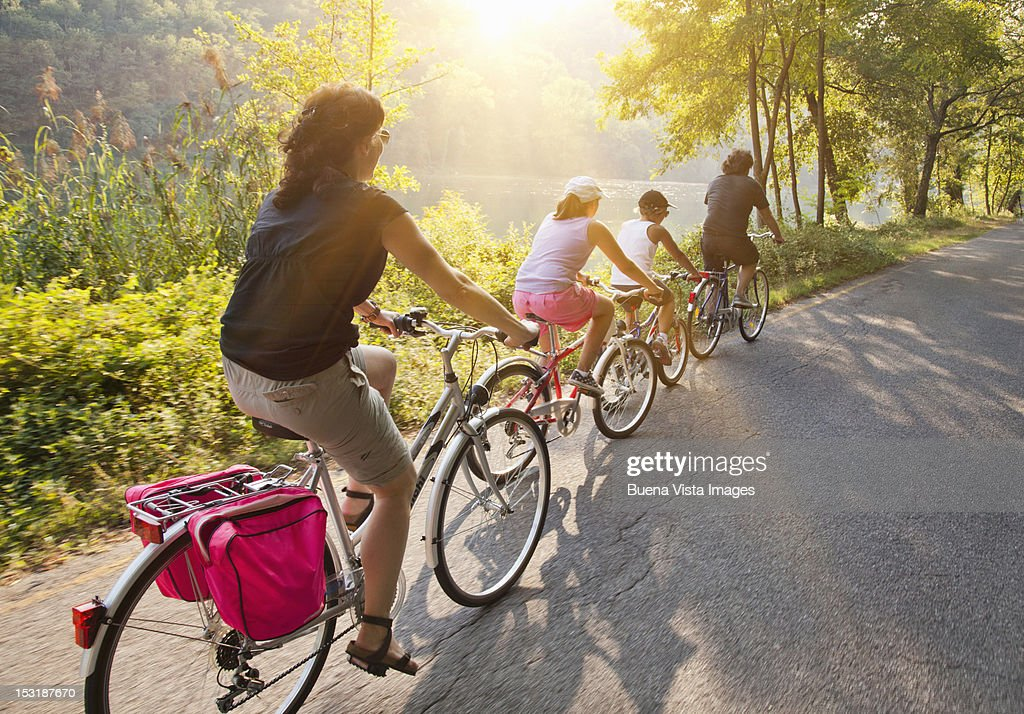 Family on bicycle on a country road : Stock Photo