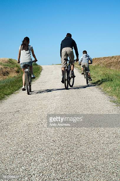 Family on bikes cycling in the countryside