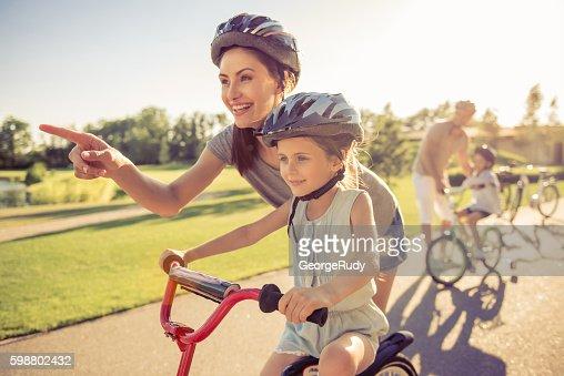 Family on bikes : Stock Photo
