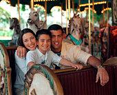 Family on carousel