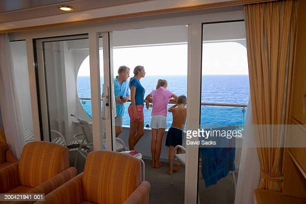 Family on cruise ship looking at ocean