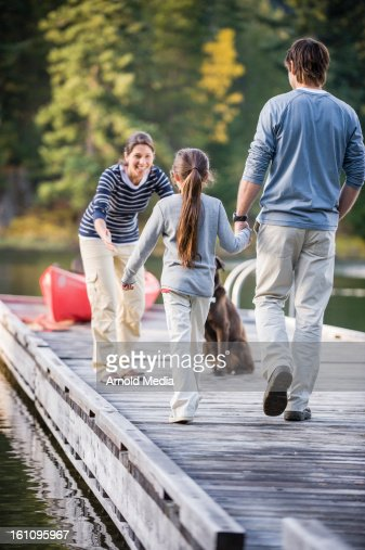 Family on dock : Stock Photo