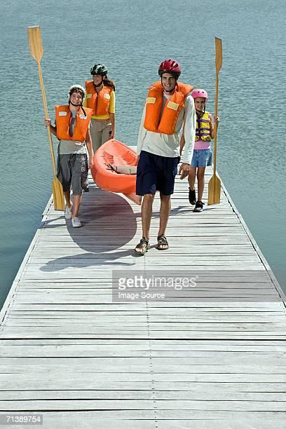 Family on jetty with canoe