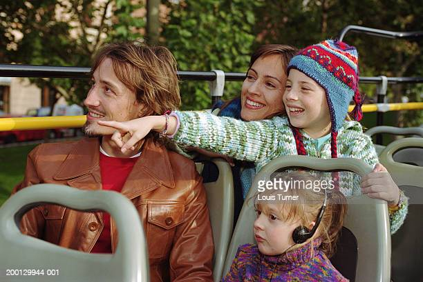 Family on open top bus, girl pointing (8-10)