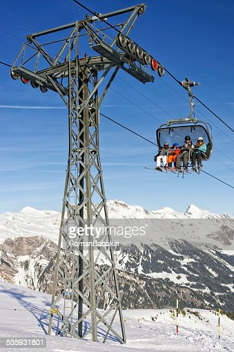 Family on ski in the cable car : Stock Photo