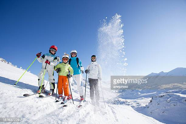 family on skis at blue sky