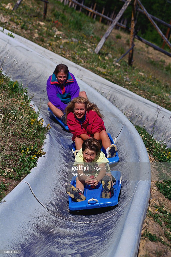 ACTLI094 Family on slides : Stock Photo