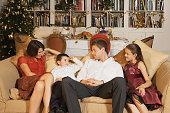 Family on sofa at Christmas