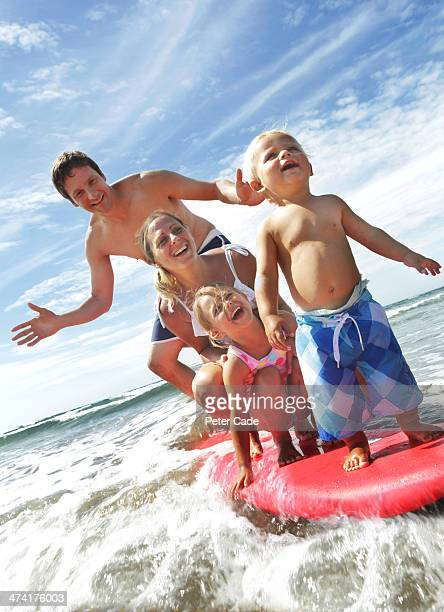 Family on surfboard in sea