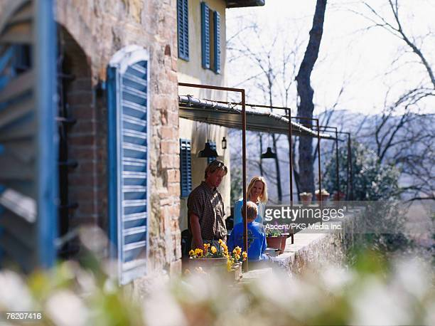 Family on terrace of villa, Livorno, Tuscany, Italy, Europe