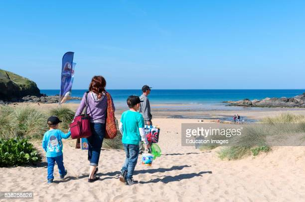 family on the beach at poldhu cove in cornwall England Britain UK