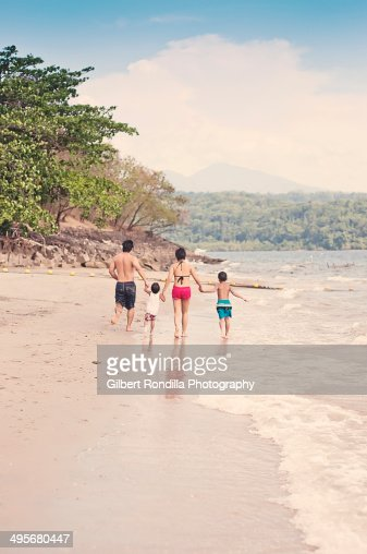 Family on the beach : Stock Photo