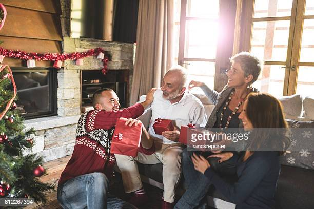 family on the living room for christmas