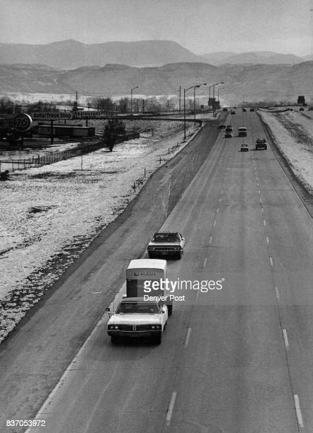 Family On The Road The Earl Miller family driving through Denver area with worldly possessions in two cars and trailer above foreground in search of...