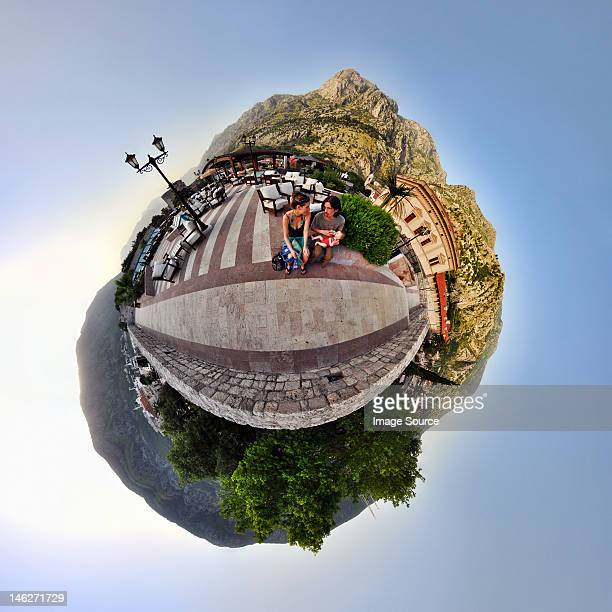 Family on vacation in Kotor, Montenegro, little planet effect