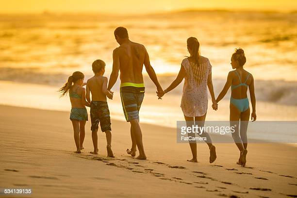 Family on vacation walking on beach