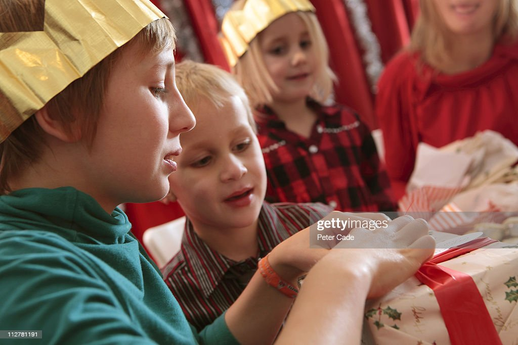 family opening present at christmas : Stock Photo