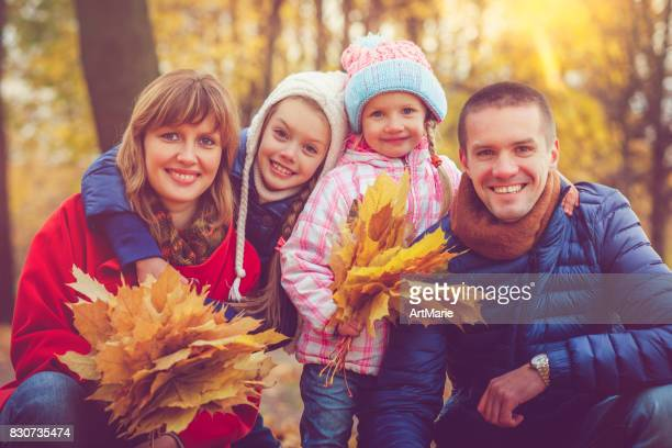 Family outdoors in autumn