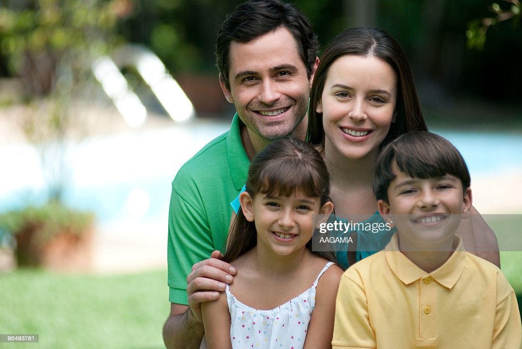Family outdoors in backyard : Photo