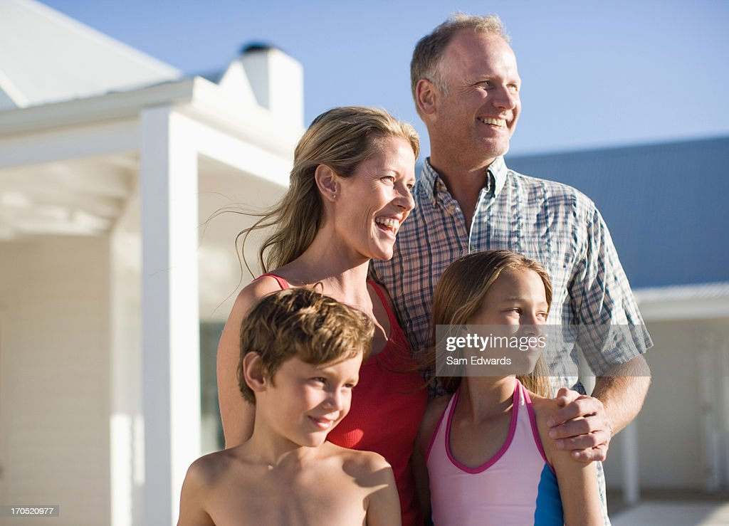 Family outdoors in swimming suits : Stock Photo