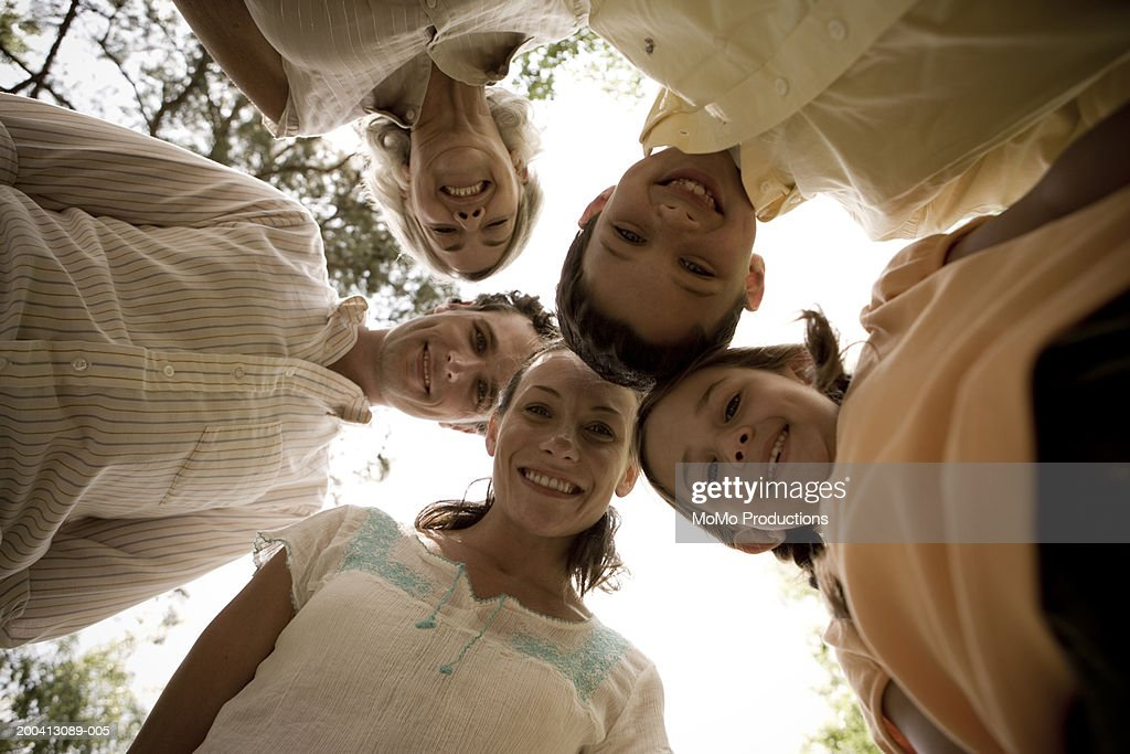 Family outdoors, smiling, portrait, low angle view : Stock Photo