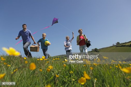 family outdoors together flying kite : Bildbanksbilder