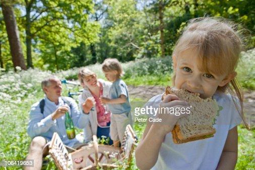 Family outside having a picnic : Stock Photo