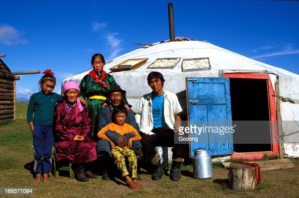 Family outside their yurt in Northern Mongolia Mongolia
